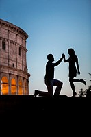 Couple at Roman Colosseum. Rome. Italy.