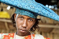 Portrait of a herero woman wearing traditional hat.