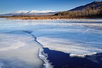Snowcapped Presidential Range from Cherry Pond at Pondicherry Wildlife Refuge in Jefferson, New Hampshire USA. The Presidential Range Rail Trail (Coho...