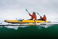 Lindblad Expeditions guests kayaking amongst ice in Neko Harbor, Antarctica.