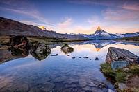 The Matterhorn reflected in Lake Stellisee at dawn Zermatt Canton of Valais Pennine Alps Switzerland Europe.