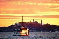 Bosphorus passenger ferry passes Seraglio Point, Topkapi Palace and Hagia Sophia, city centre of Istanbul, Turkey. Looking S. W.