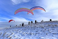 Paragliders about to take off from snowy Mam Tor near Castleton, Derbyshire, Peak District National Park, England, UK.