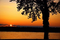 The sun sets on the Mississippi River, just north of Memphis Tennessee.