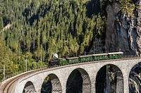 Historical steam train at Landwasser Viaduct, Grisons, Switzerland.