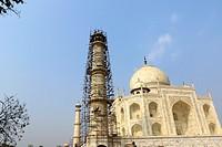 Taj Mahal white marble mausoleum pillar renovation Mughal architecture cleaning minar at southern bank Yamuna River Agra India on 15 February 2016.