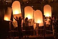 Hot air balloons Loy Krathong festival Nawarat Bridge Chiang Mai Thailand.