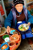 Dali Old Town, Sidewalk vendor selling deep fried potatoes, Bei People´s Village in Dali, Yunnan Province, China