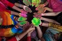 DHAKA, BANGLADESH - MARCH 23 : Bangladeshi youth playing coloured powders during Holi celebrations in Dhaka, Bangladesh on March 23, 2016. . Holi is t...