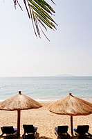 Sanya, Hainan island, China - The view of beautiful beach in the daytime with beach chair.