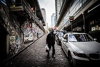 Man walking to the Post Alley under Pike Place Market, Seattle, Washington state.