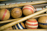Old wooden croquet game set in a box.