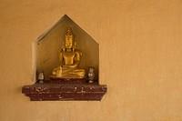A small Buddha in a niche at Shwezigon Pagoda.