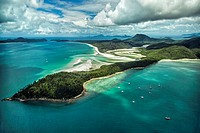 Aerial view from Hill Inlet of the waters and swirling sands of Whitsunday Island with Whitehaven Beach in the distance in Queensland, Australia.