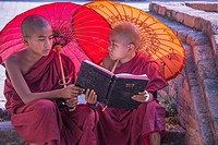 Two young monks study outside Bagan´s Sularmuni Temple.