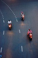 motor cycles take a turn near Silom, Bangkok.