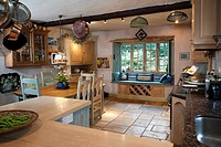Farmhouse style kitchen with dining area. Editorial Use Only.