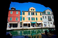 Colourful buildings along the canals of Murano, Venice, Italy.