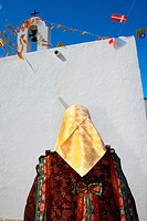 A typical woman in Festes del Pilar, a traditional celebration. Formentera (Balearic Islands).