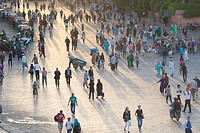 People at Jemaa el Fna square in late afternoon light, Marrakech, Morocco.