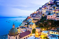 Positano, Amalfi Coast, Campania, Sorrento, Italy. View of the town and the seaside in a summer sunset.