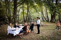 people having pic nic and enjoying the Greek countryside.