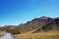winding road through Lindis Pass, Canterbury, New Zealand.