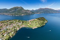 Aerial view of the village of Bellagio framed by clear waters of Lake Como with sailboats and gardens Lombardia Italy Europe.