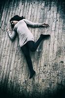 Dead woman´s body on the floor.