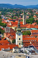Aerial view of rooftops and the towers of St Mary's Church and St Francis Church in Zagreb, Croatia.