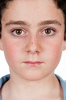 front view of a face of a boy with freckles.