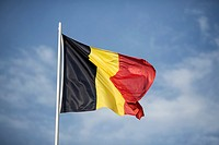 Belgian flag flies on the Saint-Charles de Potize Military Cemetery, Ypres, Belgium.