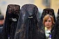 Women with mantilla and comb in the Good Friday procession of San Lorenzo de El Escorial (Madrid), Spain.