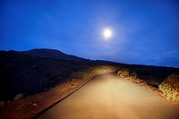 Spain, Canary Islands, El Hierro. Night view of the road from La Restinga.