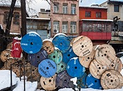 Old cable reels stacked in front of old houses on Karakoy waterfront, Istanbul, Turkey.