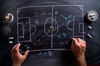 Lesson in tactics and the football patterns drawn with chalk on blackboard.