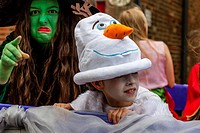 Colourful Characters Take Part In A Street Procession During The St Lawrence Fair, Hurstpierpoint, Sussex, UK.