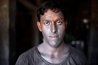 Portrait a Bnagladeshi labor who work in a silver cooking pot factory in Dhaka. Children as young as teen operate heavy machinery unaided, their faces...