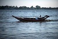 A long boat at the Irrawaddy River in Yangon, Myanmar.