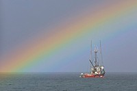 Fishing boat and rainbow, near Nanaimo, Vancouver Island, British Columbia.