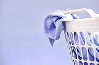 A studio photo of a laundry washing basket.