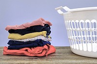 A studio photo of ironing and laundry items.