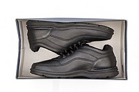 A studio photo of black walking shoes.