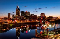 Twilight view of the Nashville Tennessee, skyline with the Cumberland River in the foreground.