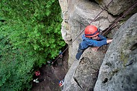 North America, Canada, Ontario, near Ravenna, Metcalfe Rock, Niagara Escarpment named in 1990 by UNESCO as a World Biosphere Reserve, . girl rock clim...