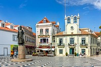 View of the historical city center with Edificio do Relogio and monument of the King Pedro I, in Cascais, Portugal on September 29, 2015.