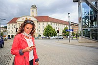 portrait of a young woman at bus and rail station.
