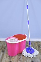 A studio photo of a cleaning mop.