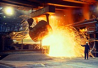 smelter, smelting iron ore, adding molten pig iron from blast furnace.