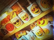 Emoji mugs in shop window England UK United Kingdom GB Great Britain.